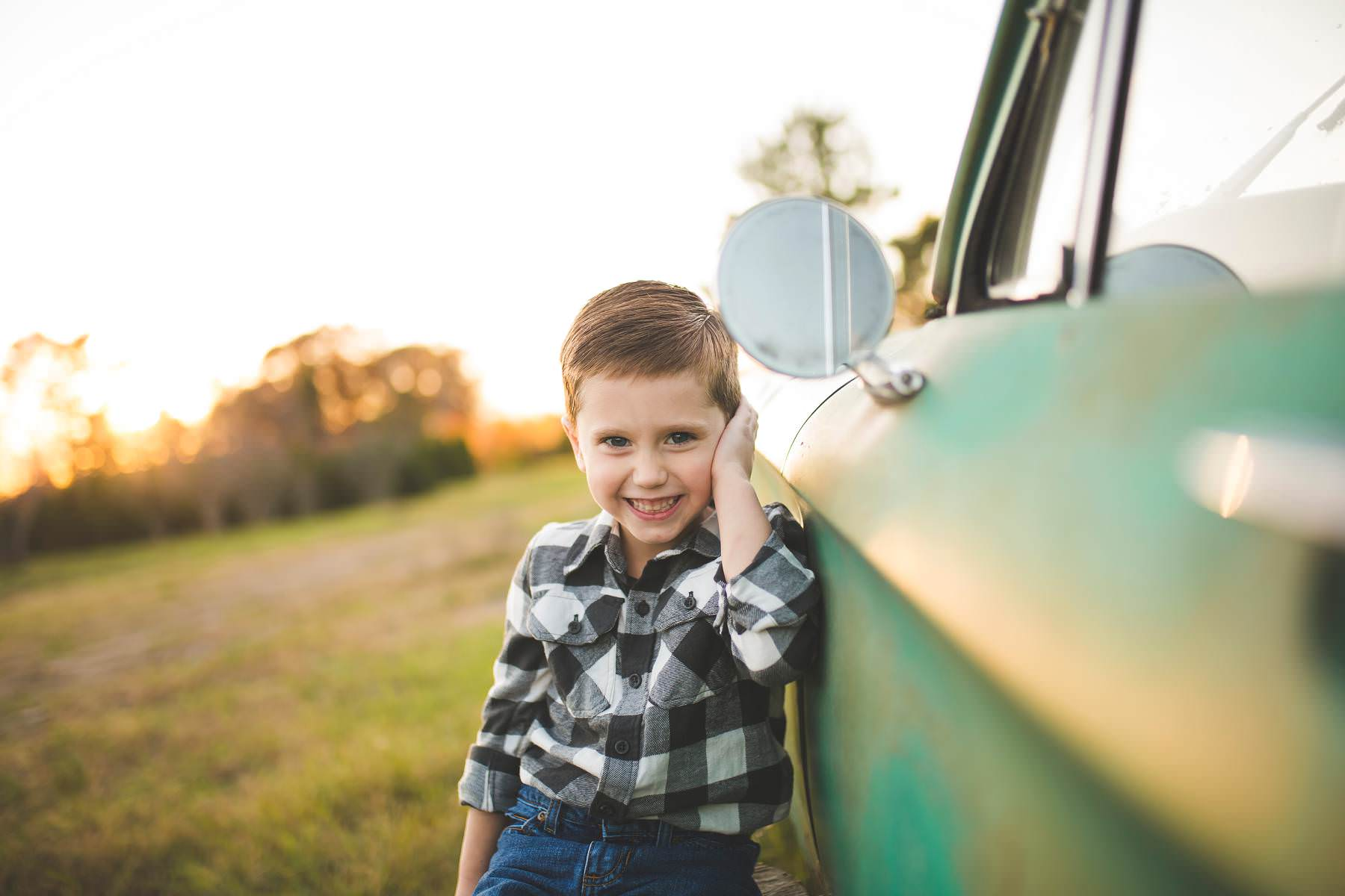 boy-wants his picture taken by classic car