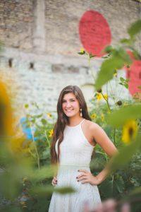 senior girl in sunflower city park minneapolis