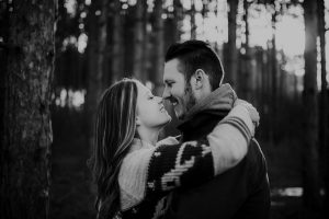 engaged couple kissing in tall pines north branch minnesota