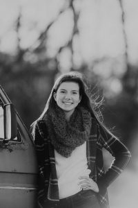 senior girl by van forest lake